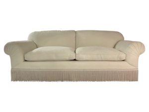 Custom Cream Colored Rolled Arm Sofa with Bouillon Fringe Skirt